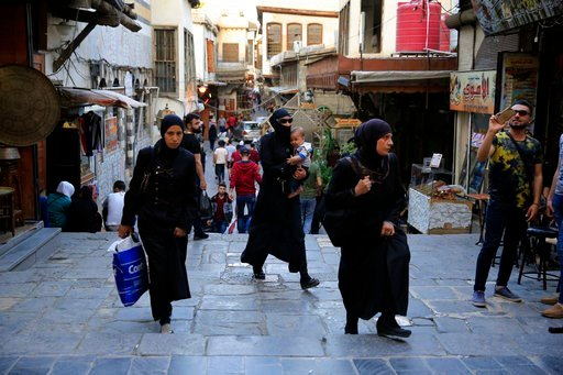 (AP Photo/Hassan Ammar). Syrians walk in the Hamidiyeh Market, in the Old City of Damascus, Syria, Sunday, April 15, 2018. Syria's President Bashar Assad spoke Sunday to a group of visiting Russian politicians saying that Western airstrikes against his...
