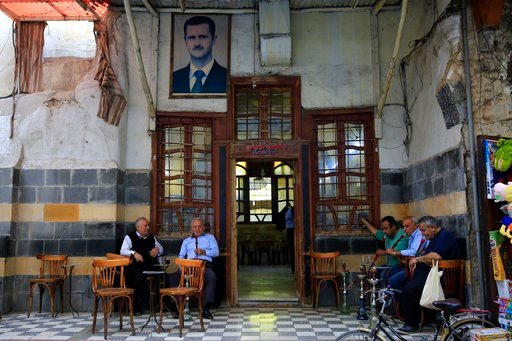 (AP Photo/Hassan Ammar). Syrians smoke water pipes at a coffee shop at the Hamidiyeh market, in the Old City of Damascus, Syria, Sunday, April 15, 2018. Syria's President Bashar Assad spoke Sunday to a group of visiting Russian politicians saying that ...