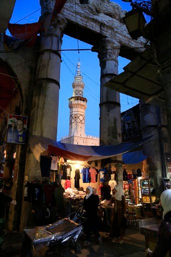 (AP Photo/Hassan Ammar). Woman shop at the Hamidiyeh Market that was named after the 34th Sultan of the Ottoman Empire Abdul Hamid II, in the Old City of Damascus, Syria, Sunday, April 15, 2018. Syria's President Bashar Assad spoke Sunday to a group of...