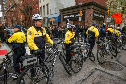 (Michael Bryant/The Philadelphia Inquirer via AP). Philadelphia police form a line in front of the Starbucks that was at the center of a Black Lives Matter protest on Sunday, April 15, 2018. Two black men were arrested Thursday after Starbucks employee...