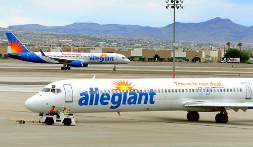 (AP Photo/David Becker, File). In this May 9, 2013, file photo, two Allegiant Air jets taxi at McCarran International Airport in Las Vegas.