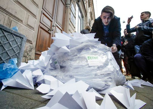 (AP Photo/Dmitri Lovetsky). Activists bring a sack with about 2,000 paper airplanes symbolising the logo of the messaging app Telegram to the door of St. Petersburg's department of Roskomnadzor, the state communications oversight agency, to protest aga...