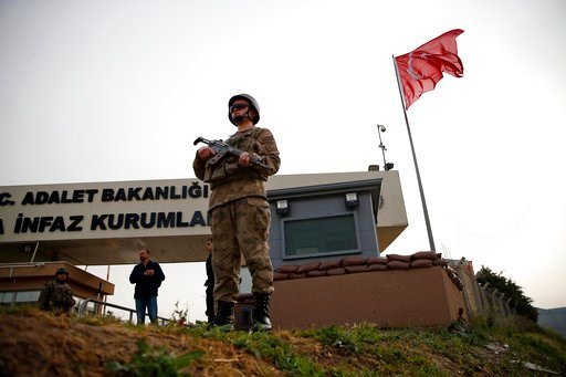 (AP Photo/Lefteris Pitarakis). Members of Turkish forces guard the entrance to the prison complex in Aliaga, Izmir province, western Turkey, where jailed US pastor Andrew Craig Brunson is held and is appearing on his trial at a court inside the complex...