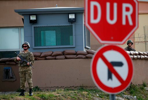 (AP Photo/Lefteris Pitarakis). Members of Turkish forces guard the entrance to the prison complex in Aliaga, Izmir province, western Turkey, where jailed U.S. pastor Andrew Craig Brunson is held and is appearing on his trial at a court inside the compl...