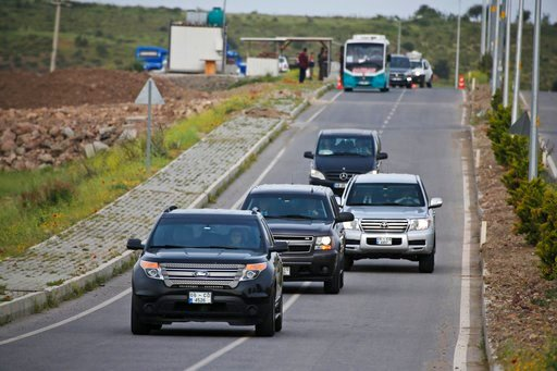 (AP Photo/Lefteris Pitarakis). A convoy of U.S. diplomatic vehicles is driven to the prison complex in Aliaga, Izmir province, western Turkey, where jailed US pastor Andrew Craig Brunson is held and is appearing on his trial at a court inside the compl...
