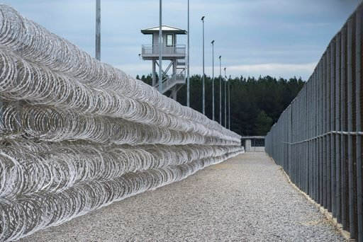 (AP Photo/Sean Rayford, File). FILE - In this Feb. 9, 2016, file photo, razor wire protects a perimeter of the Lee Correctional Institution in Bishopville, S.C. A South Carolina prisons spokesman says several inmates are dead and others required outsid...