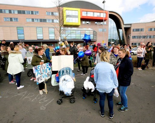 (John Stillwell/PA via AP). Protestors gather outside Alder Hey Children's Hospital where a terminally-ill 23-month-old toddler Alfie Evans is hospitalized, in Liverpool, Britain, Monday, April 16, 2018.  Pope Francis offered prayers after his traditio...