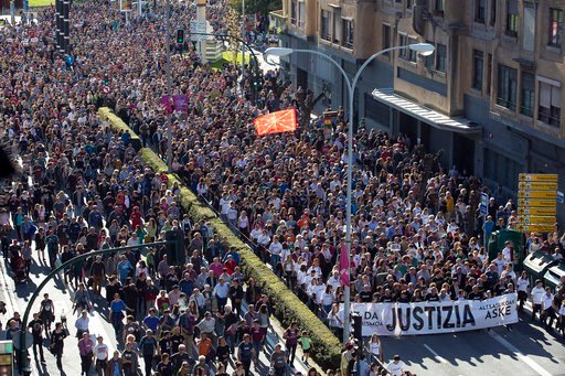 (AP Photo/Unai Beroiz). In this photo taken on Saturday April 14, 2018, tens of thousands of people march in Pamplona, the capital of the province where Alsasua is located, protesting the terrorism charges brought against eight defendants for a fight i...