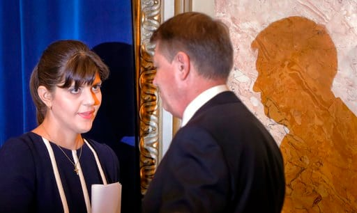 (AP Photo/Vadim Ghirda, File). FILE- In this Thursday, Feb. 23, 2017 file photo, Romania's chief anti-corruption prosecutor Laura Codruta Kovesi, who heads the country's anti-graft agency (DNA), left, shakes hands with Romanian President Klaus Iohhanis...