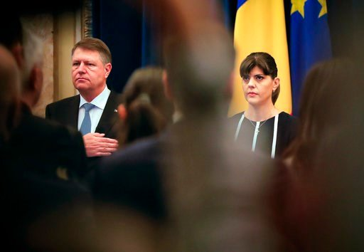 (AP Photo/Vadim Ghirda, File). FILE- In this Thursday, Feb. 23, 2017 file photo, Romania's chief anti-corruption prosecutor Laura Codruta Kovesi, who heads the country's anti-graft agency (DNA), right, stands next to Romanian President Klaus Iohhanis, ...
