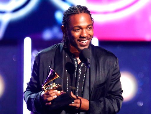 """(Photo by Matt Sayles/Invision/AP, File). FILE - In this Jan. 28, 2018 file photo, rapper Kendrick Lamar accepts the award for best rap album for """"Damn"""" at the 60th annual Grammy Awards in New York. On Monday, April 16, 2018, Lamar won the Pulitzer Pri..."""