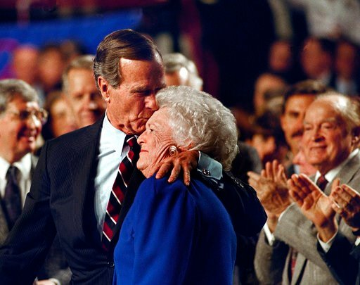 (AP Photo/Ron Edmonds/File). FILE - In this Nov. 2, 1992, file photo, entertainer Bob Hope, back right, applauds as President George H. W. Bush kisses his wife Barbara during a pre-election rally at the Astro Arena in Houston. Former first couple Georg...