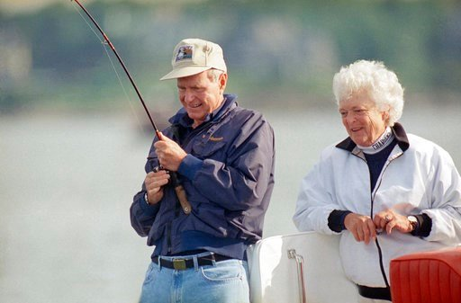 (AP Photo/Susan Walsh, File). FILE - In this Aug. 7, 1991, file photo, Barbara Bush watches as President George Bush reels in a fish aboard their boat Fidelity, just off shore from their Vacation home at Walkers Point in Kennebunkport, Me. Former first...