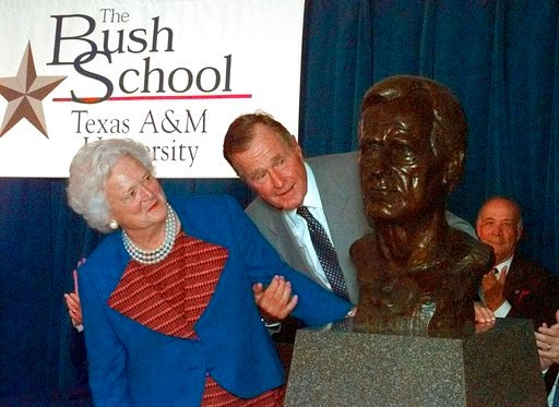 (AP Photo/David J. Phillip). FILE - In this Sept. 10, 1997 file photo, former President George Bush and his wife Barbara unveil a bust of the president during a ceremony to open The Bush School of Government and Public Service at Texas A&M Universi...