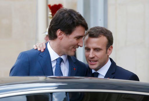 (AP Photo/Michel Euler). Canadian Prime Minister Justin Trudeau, left, says goodbye to French President Emmanuel Macron after a meeting at the Elysee Palace in Paris, Monday, April 16, 2018.