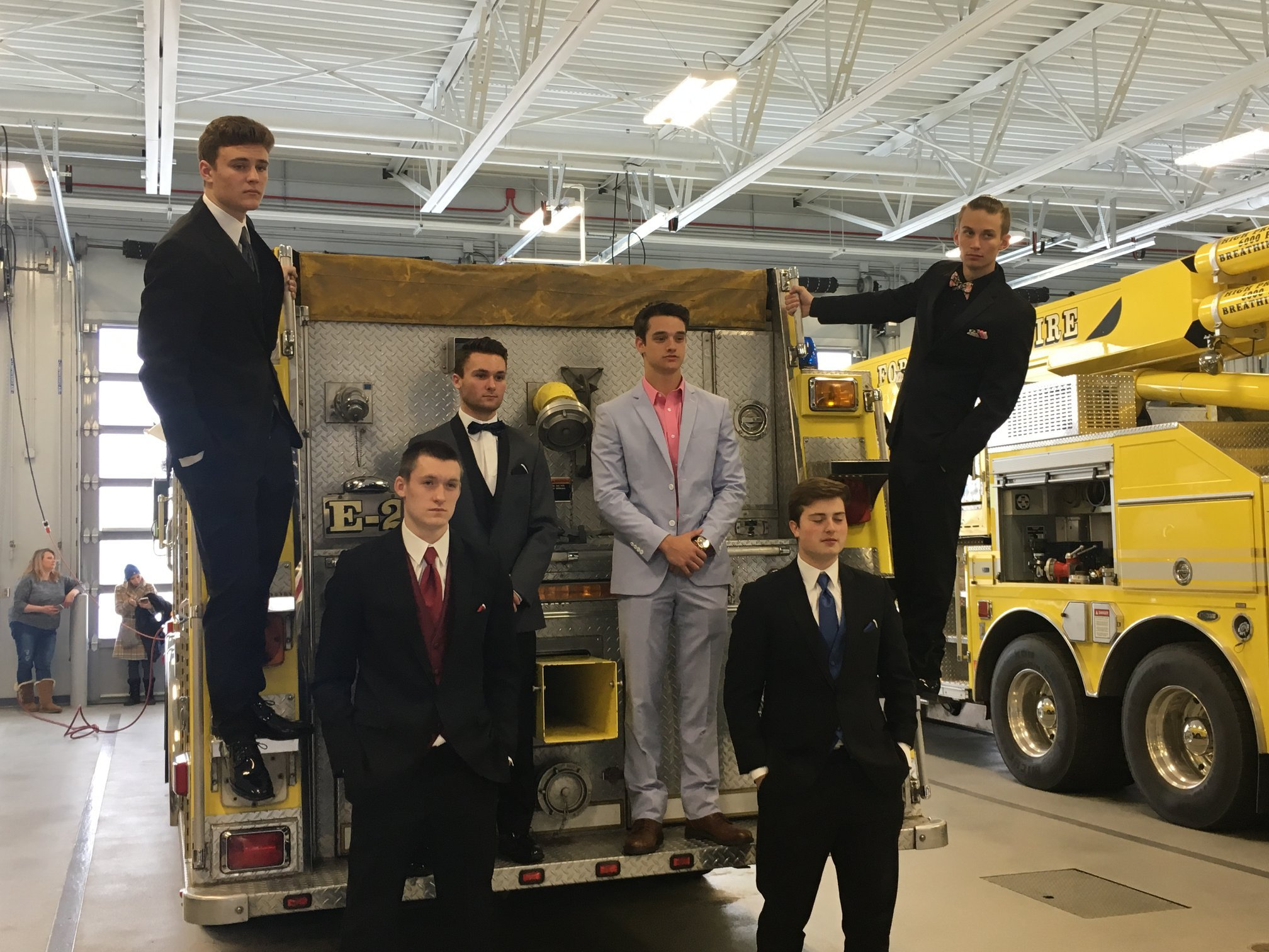 The students posed in their formal clothes on firetrucks and in the firehouse. (Source: Forest Lake Fire Department)