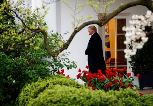 (AP Photo/Carolyn Kaster). President Donald Trump walks from the Oval Office of the White House to Marine One in Washington, Monday, April 16, 2018, for the short trip to Andrews Air Force Base en route to Miami.
