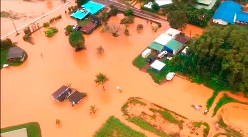 (Petty Officer 3rd Class Brandon Verdura/U.S. Coast Guard via AP). This Sunday, April 15, 2018 image taken from video provided by the U.S. Coast Guard shows flooding along Kauai's Hanalei Bay, Hawaii. Hawaii Gov. David Ige issued an emergency proclamat...