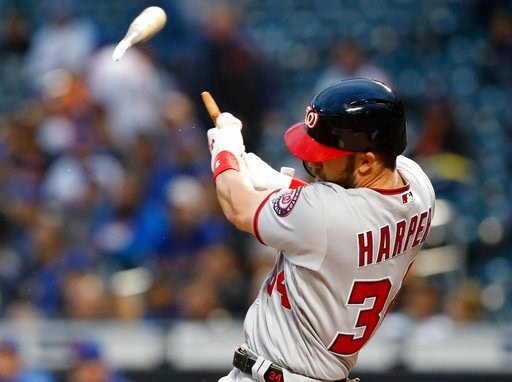 (AP Photo/Kathy Willens). Washington Nationals' Bryce Harper hits a solo home run in the first inning of a baseball game against the New York Mets, Monday, April 16, 2018, in New York.