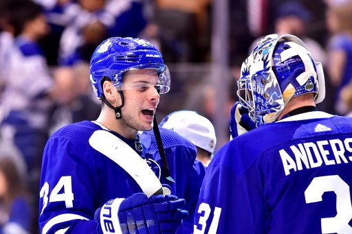 (Frank Gunn/The Canadian Press via AP). Toronto Maple Leafs centre Auston Matthews (34) and goaltender Frederik Andersen (31) celebrate after defeating the Boston Bruins in NHL round one playoff hockey action in Toronto on Monday, April 16, 2018.