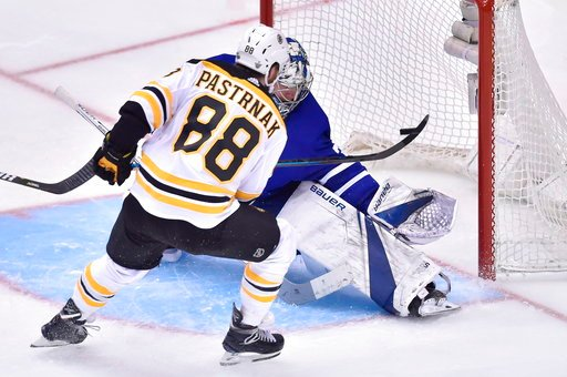 (Nathan Denette/The Canadian Press via AP). Toronto Maple Leafs goaltender Frederik Andersen (31) makes a save on Boston Bruins right wing David Pastrnak (88)during third period NHL round one playoff hockey action in Toronto on Monday, April 16, 2018.