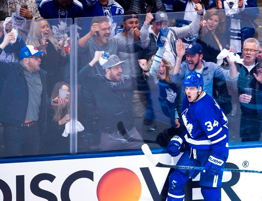 (Nathan Denette/The Canadian Press via AP). Toronto Maple Leafs center Auston Matthews (34) reacts after scoring against the Boston Bruins during second period NHL, round one playoff hockey action in Toronto on Monday, April 16, 2018.
