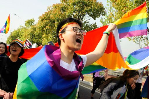 """(Jiangsu Tongtian Volunteer Group via AP). In this April 15, 2018 photo released by Jiangsu Tongtian Volunteer Group, more than 20,000 people take part in a """"Rainbow Marathon,"""" organized months earlier, to raise awareness of LGBT issues in Nanjing in e..."""