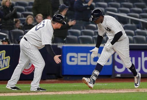 (AP Photo/Julie Jacobson). New York Yankees' Didi Gregorius is congratulated by third base coach Phil Nevin (53) after hitting a solo home run against the Miami Marlins during the seventh inning of a baseball game, Monday, April 16, 2018, in New York.