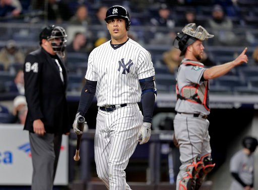 (AP Photo/Julie Jacobson). New York Yankees' Giancarlo Stanton walks back to the dugout after striking out against the Miami Marlins during the seventh inning of a baseball game, Monday, April 16, 2018, in New York.