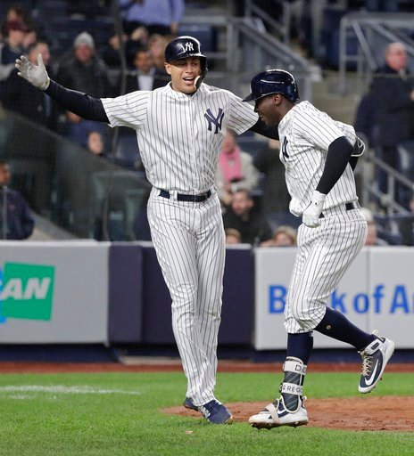 (AP Photo/Julie Jacobson). New York Yankees' Giancarlo Stanton, left, celebrates with Didi Gregorius after Gregorius hit a two-run home run against the Miami Marlins during the fourth inning of a baseball game, Monday, April 16, 2018, in New York.