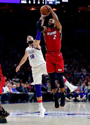 (AP Photo/Chris Szagola). Miami Heat's Wayne Ellington, right, shoots with Philadelphia 76ers' Marco Belinelli, left, of Italy, defending during the first half in Game 2 of a first-round NBA basketball playoff series, Monday, April 16, 2018, in Philade...