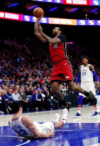 (AP Photo/Chris Szagola). Miami Heat's James Johnson, right, shoots and draws the foul call on Philadelphia 76ers' Ersan Ilyasova, left, of Turkey, during the first half in Game 2 of a first-round NBA basketball playoff series, Monday, April 16, 2018, ...