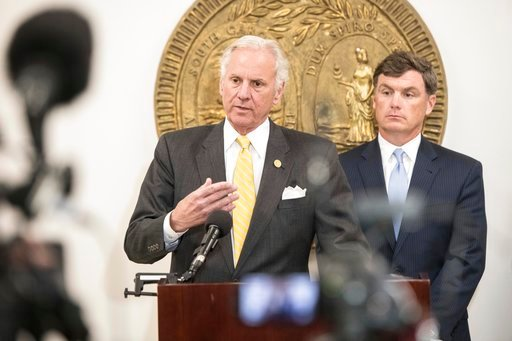 (AP Photo/Sean Rayford). South Carolina Gov. Henry McMaster, left, and South Carolina Department of Corrections Director Bryan Stirling address the media at a press conference Monday, April 16, 2018, in Columbia, S.C., regarding a deadly prison riot at...