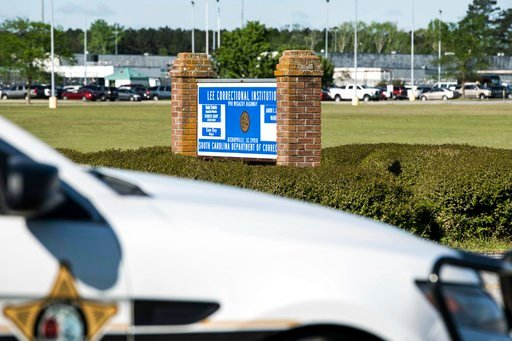 (AP Photo/Sean Rayford). A police vehicle sits outside the Lee Correctional Institution on Monday, April 16, 2018, in Bishopville, S.C. Multiple inmates were killed and others seriously injured amid fighting between prisoners inside the maximum securit...