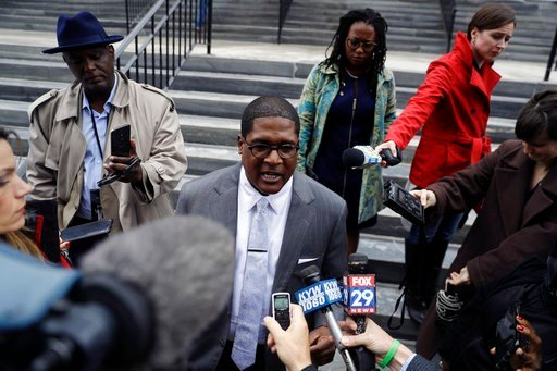 (AP Photo/Matt Slocum). Bill Cosby's spokesman Andrew Wyatt speaks to the media outside the Montgomery County Courthouse during a break in Cosby's sexual assault retrial, Monday, April 16, 2018, in Norristown, Pa.