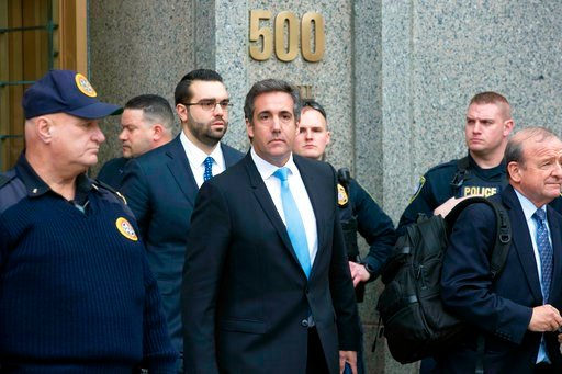 (AP Photo/Mary Altaffer). In this April 16, 2018, photo, Michael Cohen, center, President Donald Trump's personal attorney, leaves federal court in New York. Lawyers who have been asked to help represent President Donald Trump have spurned the assignme...