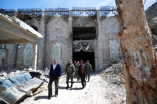 (AP Photo/Hassan Ammar). Russian military police officers check a weapons factory left behind by members of the Army of Islam group, in the town of Douma, the site of a suspected chemical weapons attack, near Damascus, Syria, Monday, April 16, 2018.