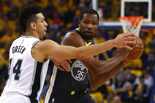 (AP Photo/Ben Margot). Golden State Warriors' Kevin Durant (35) is guarded by San Antonio Spurs' Danny Green (14) during the first quarter in Game 2 of a first-round NBA basketball playoff series Monday, April 16, 2018, in Oakland, Calif.
