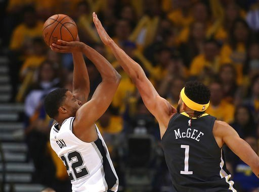 (AP Photo/Ben Margot). San Antonio Spurs' Rudy Gay, left, shoots against Golden State Warriors' JaVale McGee (1) during the first quarter in Game 2 of a first-round NBA basketball playoff series Monday, April 16, 2018, in Oakland, Calif.
