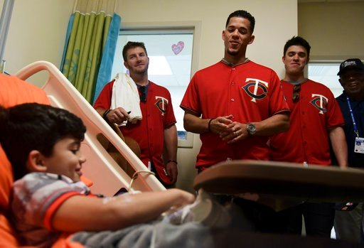 (AP Photo/Carlos Giusti). Lucas Suarez smiles during a visit from Minnesota Twins starting pitcher Jose Berrios, center, and a group of his teammates, at the San Jorge Children's Hospital in San Juan, Puerto Rico, Monday, April 16, 2018. Next Tuesday a...