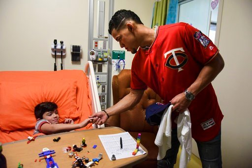 (AP Photo/Carlos Giusti). Minnesota Twins starting pitcher Jose Berrios shakes the hand of 7-year-old Lucas Suarez, during a visit by a group of Berrios' teammates at the San Jorge Children's Hospital in San Juan, Puerto Rico, Monday, April 16, 2018. N...