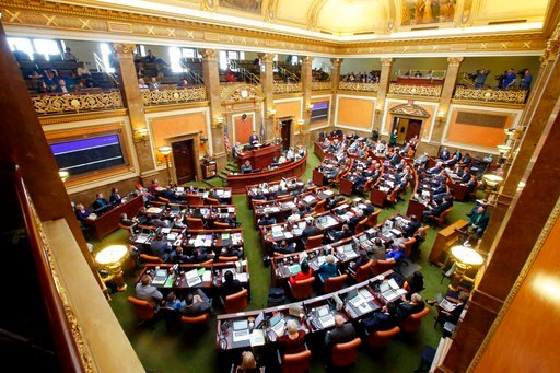(AP Photo/Rick Bowmer, File). In this Jan. 25, 2016, file photo, members of the House of Representatives look on as House Speaker Greg Hughes speaks, in Salt Lake City.