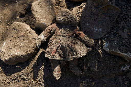 (AP Photo/Jae C. Hong). In this Wednesday, April 11, 2018, photo, a doll covered in mud lies next to a shovel and rocks outside a home heavily damaged in a mudslide, in Montecito, Calif. Months after the mudslides nearly wiped the small community of Mo...