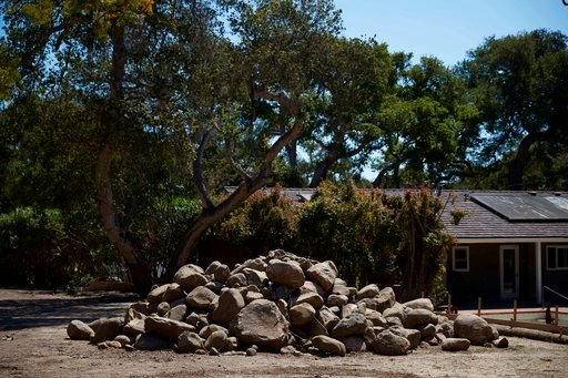 (AP Photo/Jae C. Hong). In this Wednesday, April 11, 2018, photo, boulders swept along in a mudslide are piled up in Montecito, Calif. Months after the mudslides nearly wiped the small community of Montecito off the map and killed multiple people, thos...