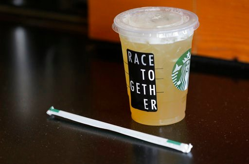 "(AP Photo/Ted S. Warren, File). In this March 18, 2015, file photo, a Starbucks iced drink with a ""Race Together"" sticker on it is shown ready for pickup at a Starbucks store in Seattle."