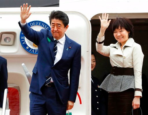 (Kenzaburo Fukuhara/Kyodo News via AP). Japanese Prime Minister Shinzo Abe waves with his wife Akie Abe while boarding his plane before departure for the U.S. at Haneda international airport in Tokyo Tuesday, April 17, 2018. Abe is heading to U.S. Pres...