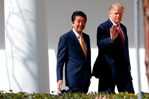 (AP Photo/Evan Vucci, File). FILE - In this Feb. 10, 2017, file photo,  Japanese Prime Minister Shinzo Abe, left, walks with U.S. President Donald Trump for a news conference at the White House in Washington. Abe is heading to Trump's Mar-a-Lago resort...