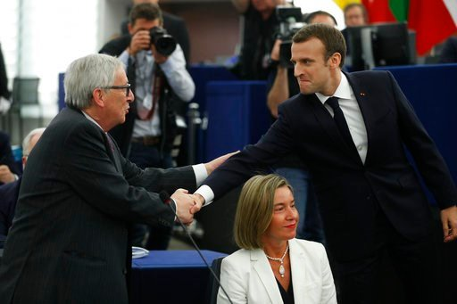 (AP Photo/ Jean Francois Badias). French President Emmanuel Macron, right, shakes hands with European Commission President Jean-Claude Juncker at the European Parliament in Strasbourg, eastern France, Tuesday, April 17, 2018. Macron is expected to outl...
