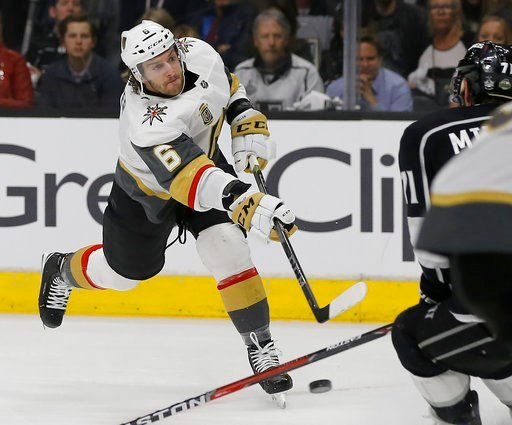 Vegas Golden Knights defenseman Colin Miller left shoots against Los Angeles Kings center Torrey Mitchell during the first period of game 4 of an NHL hockey first-round playoff series in Los Angeles Tuesday April 17