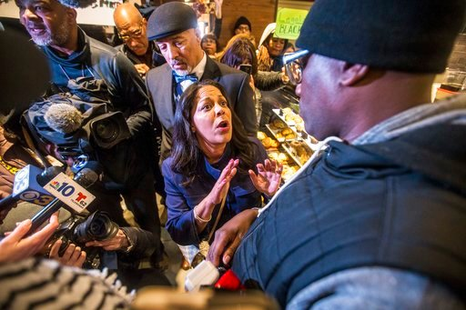 (Mark Bryant/The Philadelphia Inquirer via AP). Camille Hymes, center, regional vice president of Mid-Atlantic operations at Starbucks Coffee Company, speaks with Asa Khalif, of Black Lives Matter, right, after protesters entered the coffee shop, Sunda...
